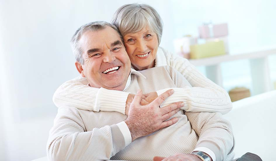 advantages-of-choosing-all-on-4-implants-old-couple-sweet-hug-smile-happy