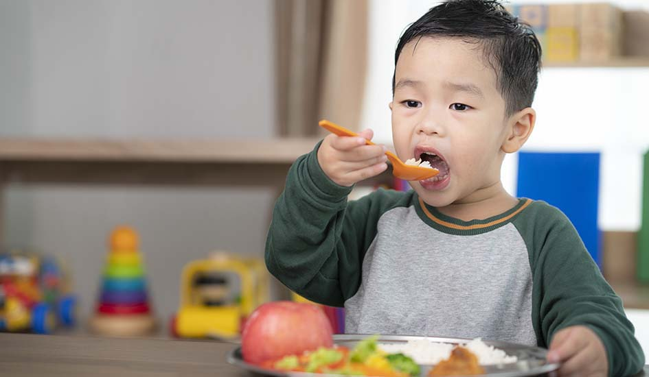 asian-student-take-lunch-class-room-by-food-tray-prepared-by-his-preschool-dental-care-oral-health
