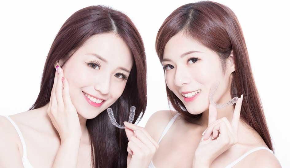 benefit-of-invisalign-two-pretty-girl-smile-dental-care-white-asian-smile-happy