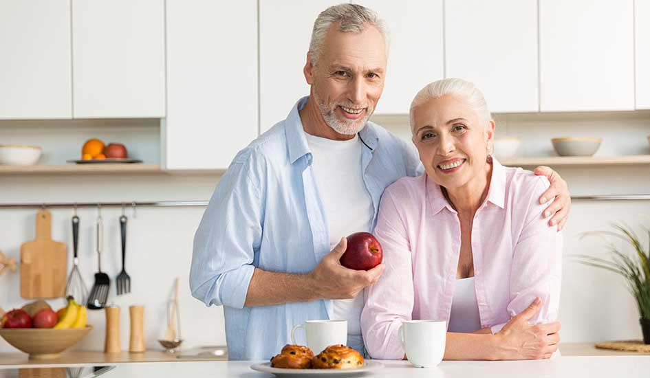 cheerful-mature-loving-couple-family-standing-kitchen-oral-health-dental-care
