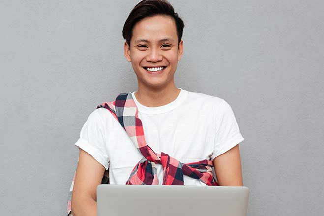 conventional-or-traditional-bridges-smile-dental-care-oral-health-handsome-young-boy-college-laptop-study-happy-cheerful-fun