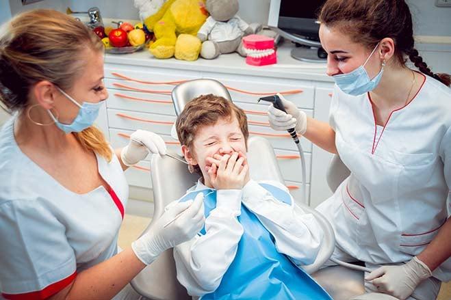 dental-fear-kid-dentist-female-scare-cry-worry-dental-care-oral-health