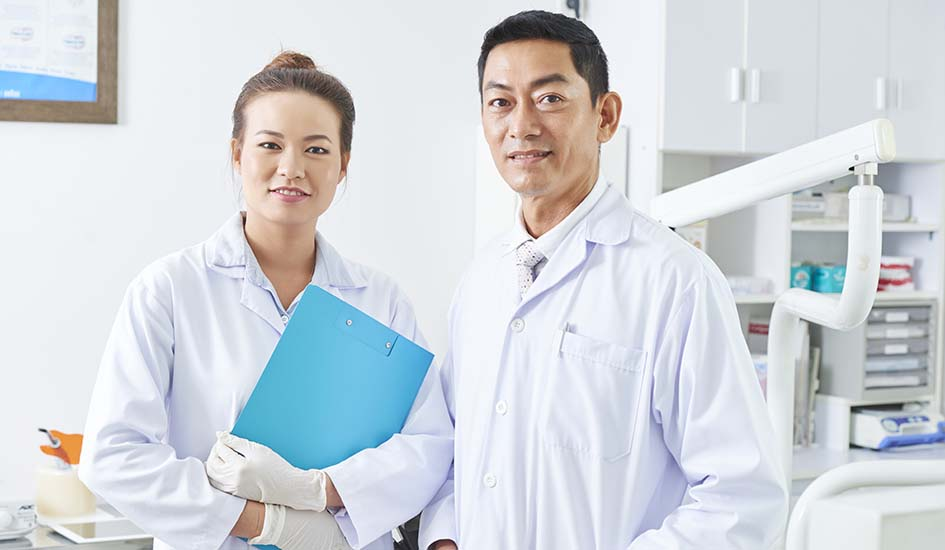 dentist-and-his-assistant-portrait-dental-care-oral-health