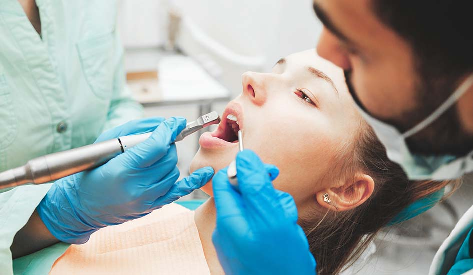 dentists-using-dental-drill-and-sucker-while-exami-dental-care-oral-health