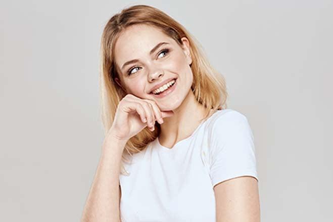 discreet-white-girl-smiling-happy-cheerful-show-teeth-oral-health-dental-care