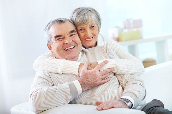 durable-and-long-lasting-old-man-old-woman-hug-smile-feeling-happy-dental-care