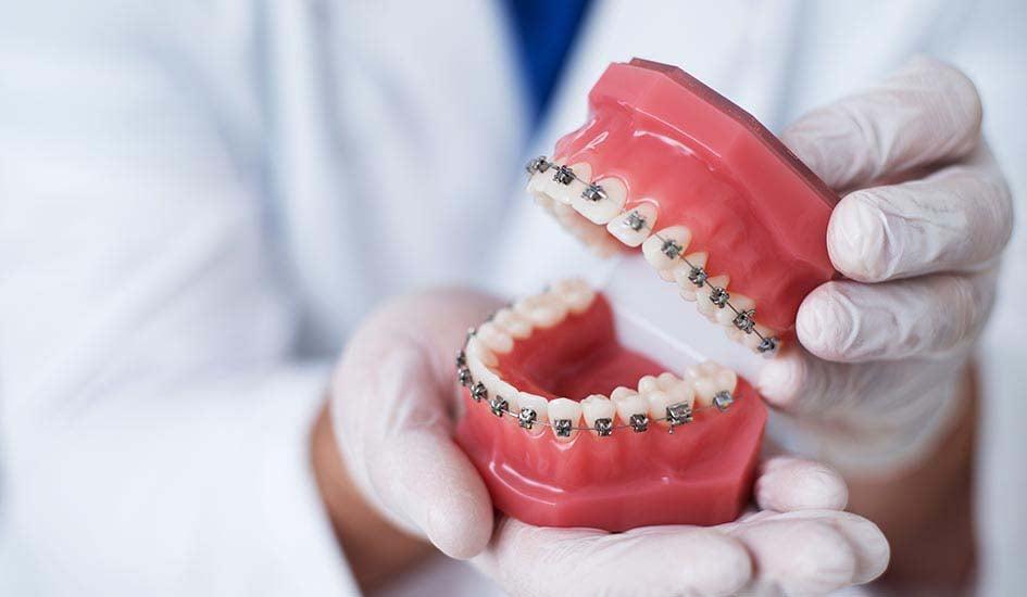 greater-comfort-dental-care-oral-health-dentist-holding