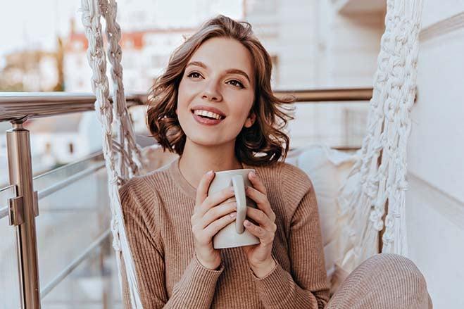 increased-comfort-beautiful-girl-smile-happy-enjoy-hot-coffee-oral-health-dental-care