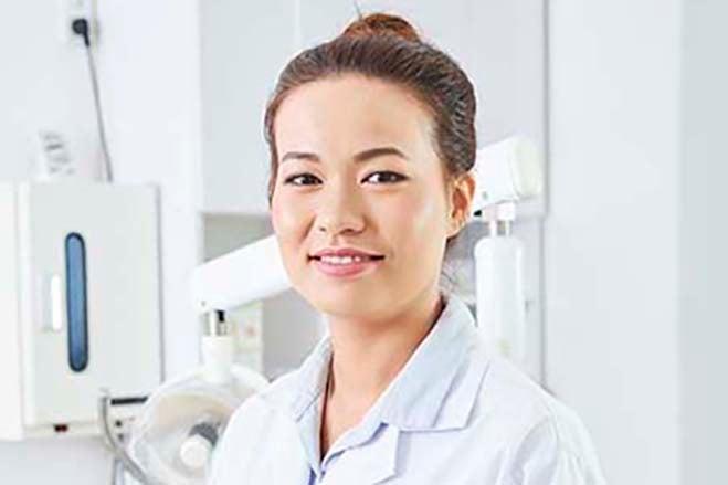 invasive-dental-procedures-female-dentist-smile-dental-care-oral-health