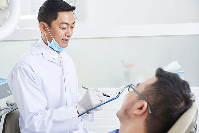 single-visit-male-dentist-face-to-face-dental-care-oral-health