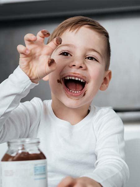 tongue-tie release-kid-dental-care-oral-health-eating-kid-happy-playful