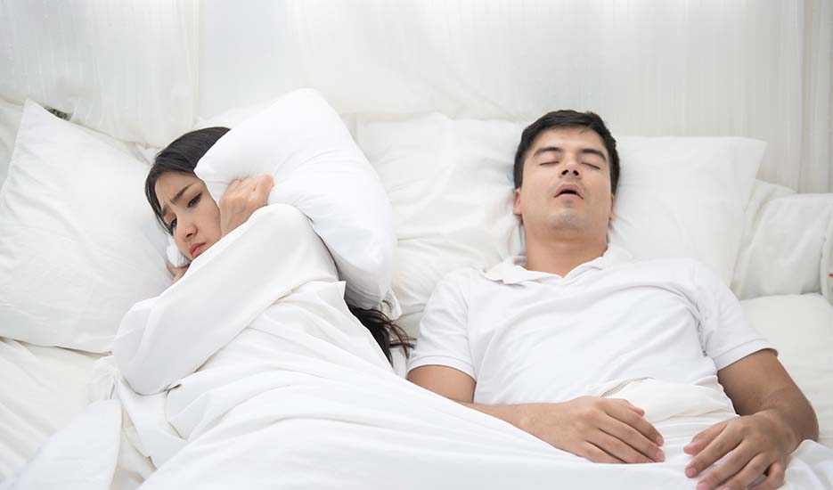 what-is-sleep-apnea-couple-sleeping-man-snoring-girl-unhappy-breath-health