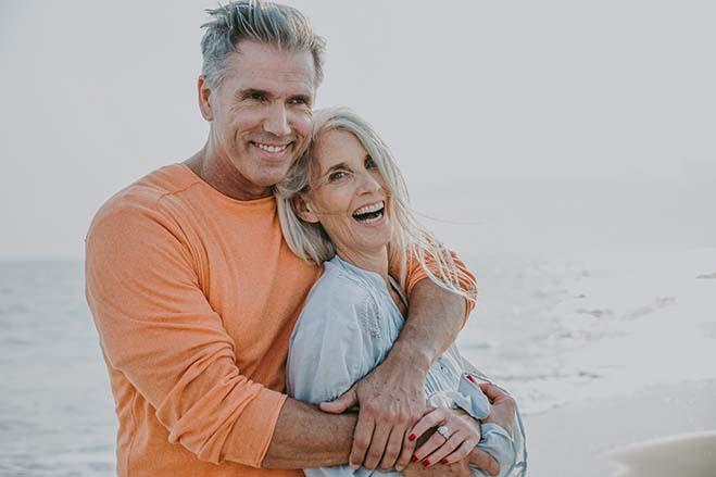 better-life-quality-old-couple-sweet-beach-happy-smile-enjoy-dental-care-oral-health-hug