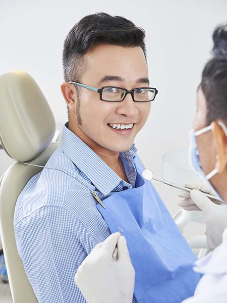 cheerful-asian-man-dentist-smile-happy-dental-care-check-up