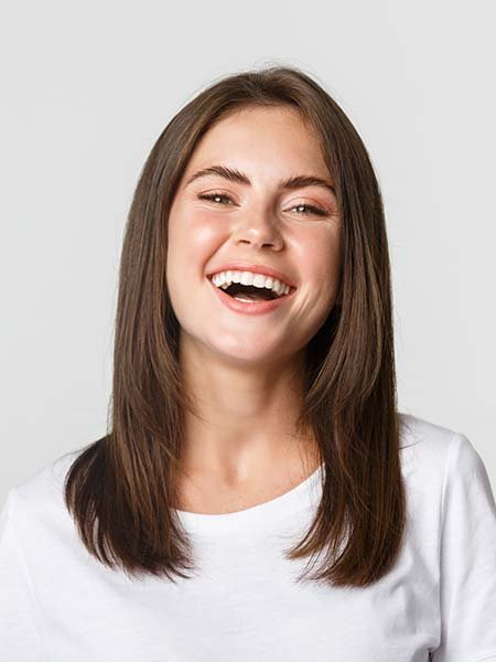 close-up-happy-brunette-girl-white-t-shirt-laughing-smiling-carefree-camera-dental-care-oral-health