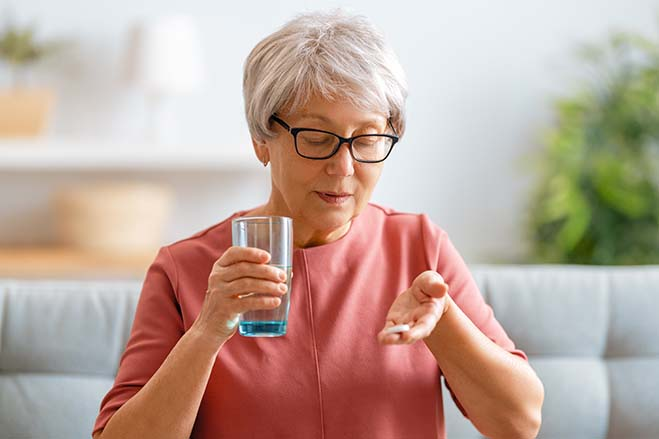 excescsive-gag-reflex-old-woman-taking-medicine-dental-care-oral-health-drink-water