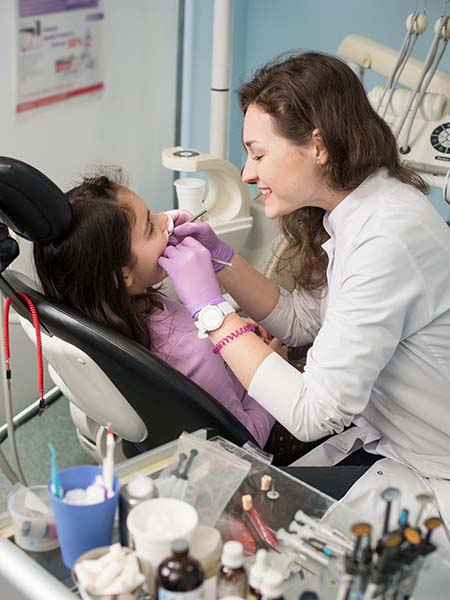 extraction-dental-check-up-oral-health-female-dentist