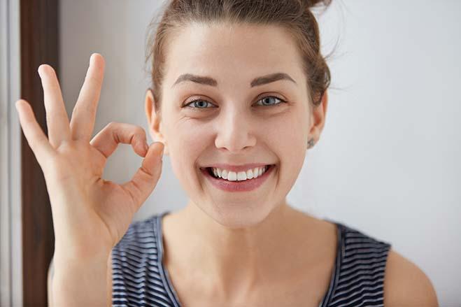 full-mouth-rehabilitation-dental-care-oral-health-happy-white-girl-smile-okay