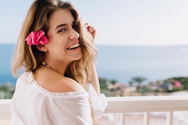 high-success-rates-dental-care-smiling-beautiful-girl-happy-holiday-beach-island-sunshine-oral-health