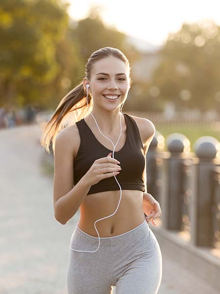 how-is-holistic-dentistry-different-from-regular-dentistry-dental-care-girl-healthy-jogging-feeling-happy-enjoy-exercise