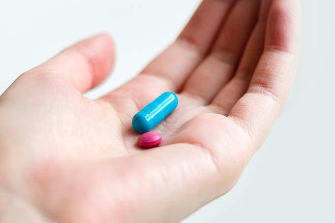 sedation-medicine-hand-holding-blue-pink-steady-emotional