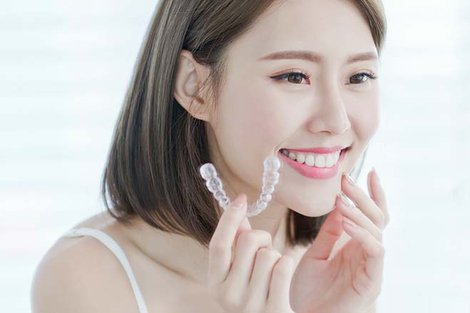 simple-to-use-pretty-asian-girl-holding-invisalign-dental-care-oral-health