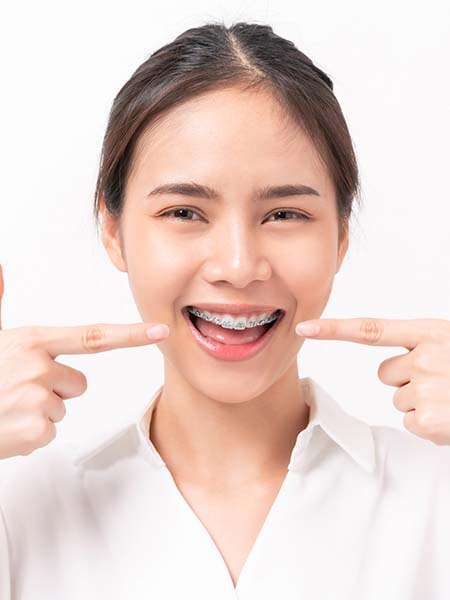 types-of-damon-braces-smiling-asian-girl-happy-dental-care-check-up-oral-health