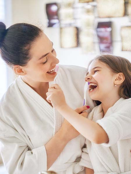 what-is-bite-balancing-family-mother-girl-child-dental-care-oral-health