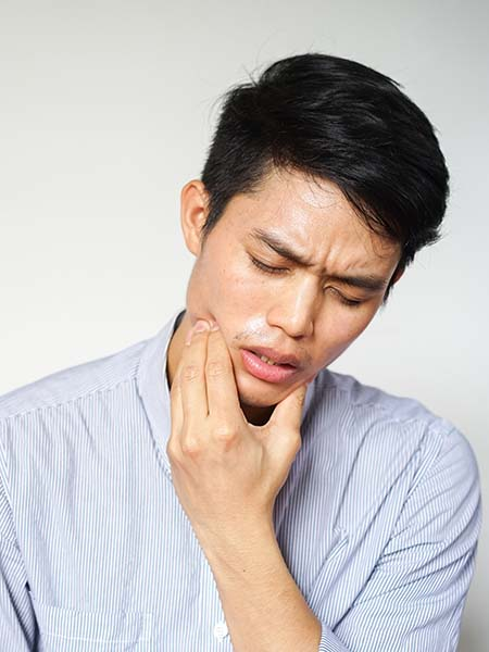 why-remove-your-wisdom-teeth-asian-boy-pain