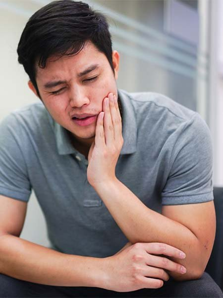 wisdom-tooth-surgery-asian-boy-feelling-pain-dental-care